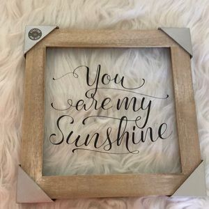 "Framed ""you are my sunshine"" picture."